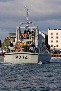 Royal Navy patrol vessel 'HMS Tracker' approaching Poole, Dorset, England, October 2010. All non-editorial uses must be cleared individually.  -  David Woodfall