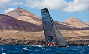 'Synergy' sailing close to the coast at the RC44 Puerto Calero Cup, Lanzarote, Canary Islands, February 2012. For editorial use only.  -  Sea & See
