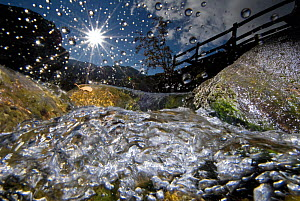 A split-level image of a mountain stream, in autumn, with water droplets on lens, Nant Ffrancon Valley, Snowdonia NP, Gwynedd, Wales, UK, October  -  Graham Eaton