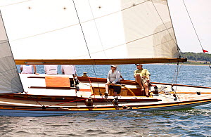 Trimming and helming in the cockpit of classic boat during in the Tiedemann Regatta, Newport, Rhode Island, USA, July 2011. All non-editorial uses must be cleared individually.  -  Onne van der Wal