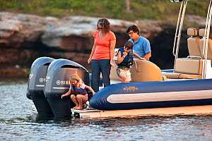 Family on board Hunt Yachts HBI (Hard Bottom Inflatable) moored off Rhode Island, USA, July 2011. All non-editorial uses must be cleared individually. - Onne van der Wal