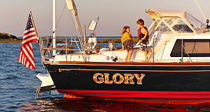 Children wearing lifejackets on board Tartan sailing boat 'Glory', moored off the coast of Newport, Rhode Island, USA, July 2011. All non-editorial uses must be cleared individually.  -  Onne van der Wal