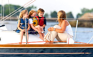Woman and children relaxing on board Tartan sailing boat 'Glory' off the coast of Newport, Rhode Island, USA, July 2011. All non-editorial uses must be cleared individually.  -  Onne van der Wal