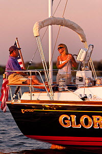Couple relaxing on board Tartan sailing boat 'Glory' off the coast of Newport, Rhode Island, USA, July 2011. All non-editorial uses must be cleared individually. - Onne van der Wal