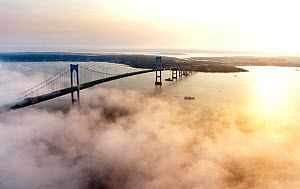 Aerial view of Highlander motor yacht approaching the Newport Bridge and a veil of thick, low cloud. Newport, Rhode Island, USA, July 2011. All non-editorial uses must be cleared individually.  -  Onne van der Wal
