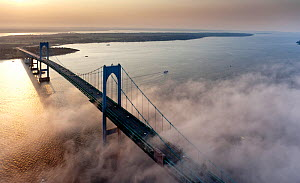 Aerial view of Highlander motor yacht passing beneath the Newport Bridge, Rhode Island, USA, July 2011. All non-editorial uses must be cleared individually.  -  Onne van der Wal