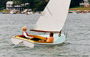Young boy helming during the Beetle Cat Championships, Weekapaug, Rhode Island, USA, August 2011. All non-editorial uses must be cleared individually.  -  Onne van der Wal