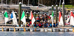 Fleet of Laser Bug dinghies tied up with instructors and children on the jetty. Public Sailing Centre, Newport, Rhode Island, USA, August 2011. All non-editorial uses must be cleared individually.  -  Onne van der Wal