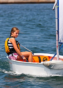 Girl sailing Laser Bug dinghy at the Public Sailing Centre, Newport, Rhode Island, USA, August 2011. All non-editorial uses must be cleared individually.  -  Onne van der Wal