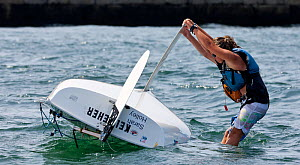 Girl attempting to right capsized Laser Bug dinghy at the Public Sailing Centre, Newport, Rhode Island, USA, August 2011. All non-editorial uses must be cleared individually.  -  Onne van der Wal
