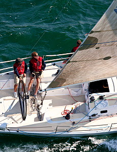 Aerial view of crew member at the helm of J Boats J/111 near to Newport, Rhode Island, USA, September 2011. All non-editorial uses must be cleared individually.  -  Onne van der Wal