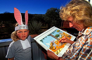 Kaye Kessing, Illustrator of the Easter Bilby book, and Ariane with Bilby ears and collar, Greater bilby (Macrotis lagotis) vulnerable species, Alice Springs, Northern Territory, Australia, May 1995  -  Roland Seitre