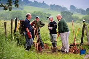 Cotswold voluntary wardens replacing a stile, Gloucestershire, UK, June 2008.  -  Nick Turner
