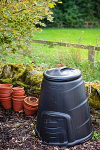 A garden compost bin with stacked flower pots next to it, September 2008.  -  Nick Turner