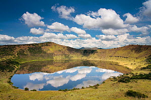 Crater lake with reflections of clouds in the water, Queen Elizabeth National Park, Uganda, January 2009.  -  Nick Turner