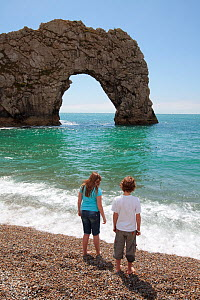 Children playing on Durdle Door Beach, Dorset, UK, May 2009.  -  Nick Turner