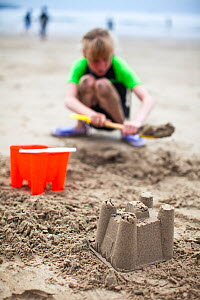 Child building a sand castle at Caerfai Bay on the Pembrokeshire Coast Path, Wales, June 2009.  -  Nick Turner