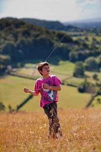 Boy kite flying on Selsley Common (unimproved grassland) Stroud, Gloucestershire, UK, August 2011. Model released  -  Nick Turner