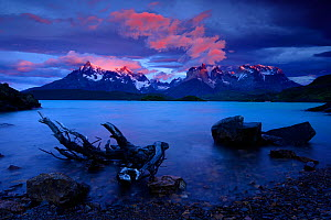 Paine mountains at dawn seen from Pehoe Lake, Torres del Paine National Park, Patagonia, Chile  -  Oriol Alamany