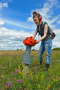 RSPB research ecologist using vacuum apparatus to sample invertebrates at the RSPB's Hope Farm Reserve, Cambridgeshire, England, UK, July  -  Chris Gomersall / 2020VISION
