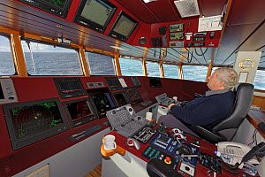 Skipper David Hutchison on the bridge of the pelagic trawler 'Charisma', Shetland Islands, Scotland, UK, October 2011 Model Release available - Chris Gomersall / 2020VISION