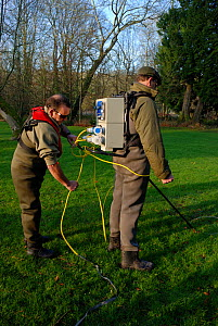 Environment Agency staff David Hunter and Richard Redsull preparing electrofishing equipment to catch and then release Atlantic salmon (Salmo salar) in connection with a breeding programme, River Itch... - Linda Pitkin / 2020VISION