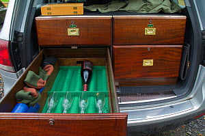Interior of fishermans car specially fitted out with cabinet to hold fishing equipment with one drawer open displaying wine bottle and glasses, Selkirkshire, Scotland, UK, October 2011  -  Rob Jordan / 2020VISION