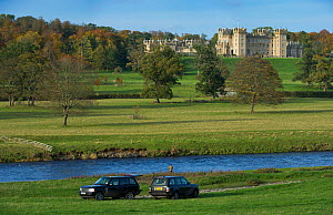 View of Floors Castle over the River Tweed, with fishermen and cars in the foreground, near Kelso, Roxburghshire, Scotland, UK, October 2010  -  Rob Jordan / 2020VISION