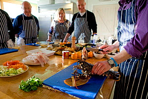 Group of people on a seafood cookery course, during the course, run by Dorset-based Fraser Christian, people learn about fish and shellfish cookery skills, with an emphasis on locally-caught sustainab...  -  Toby Roxburgh / 2020VISION