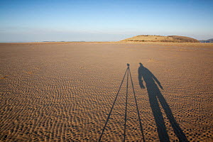 Shadow of photographer Peter Cairns on mudflats, photographed whilst on assignment for 2020VISION, Morecambe Bay, Cumbria, England, UK, February 2012 - Peter Cairns / 2020VISION