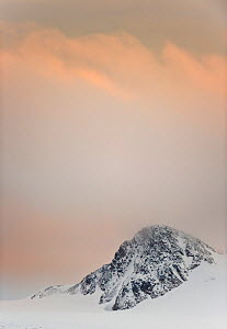 Evening sky over mountain top near Raudefjorden, Northern Spitsbergen, Svalbard, Norway, September - Roy Mangersnes