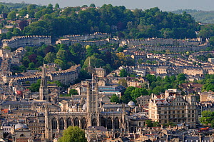Overview of Bath city showing Bath Abbey and crescents of terraced houses following contours of the hills, UK, April 2011.  -  Nick Upton