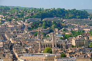 Overview of Bath city showing Bath Abbey, crescents of terraced houses following contours of the hills and shoppers on Stall and Union streets, Somerset, UK, April 2011  -  Nick Upton