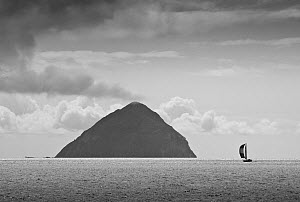 Yacht sailing past Ailsa Craig, seen from Arran. Scotland, August 2011. (This image may be licensed either as rights managed or royalty free.)  -  Merryn Thomas