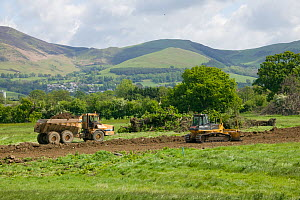 Destruction of countryside in green belt close to market town, for building of houses in flood plain, Vale of Clwyd, Denbighshire, Wales, UK.  This is a highlighted areas in UK at risk of flooding and...  -  David Woodfall