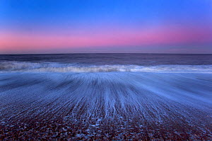 Cley Beach with retreating wave patterns, after sunset,  Norfolk, UK January - Ernie Janes