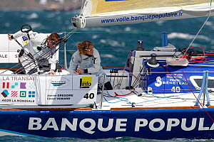 Jeanne Gregoire and Gerald Veniard on board 'Banque Populaire' during La Transat AG2R La Mondiale prologue race, Concarneau, Brittany, France, April 2012.  -  Benoit Stichelbaut