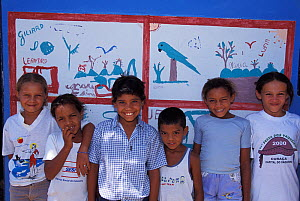 Children being taught about the Critically endangered Spix's macaw (Cyanopsitta spixii) at a school near Curaca, Bahia, Brazil, where the last known wild individuals were seen.  -  Roland Seitre