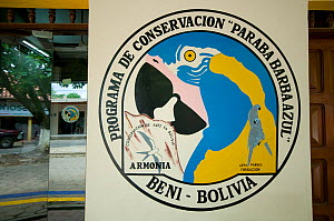 Sign for the conservation programme of the Blue throated / Wagler's macaw (Ara glaucogularis) a Critically endangered species from Trinidad, Beni, Bolivia, January 2008  -  Roland Seitre
