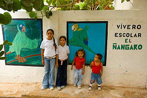 Children standing by the murals of the parrot conservation project, where Yellow-shouldered Amazons are raised. Isla Margarita, Nueva Esparta, Venezuela, 2007.  -  Roland Seitre