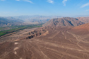 Valley, desert and mountains, with the 'Nazca Lines' visible. These are lines and patterns made around 300-600 AD by removing stones from the desert floor to expose the ground beneath. Their purpose r...  -  Roland Seitre