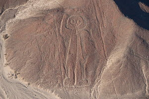 The 'astronaut' or 'giant', one of the patterns of the Nazca Lines. These are lines and patterns made around 300-600 AD by removing stones from the desert floor to expose the ground beneath. Their pur...  -  Roland Seitre