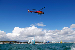 Helicopter hovering above fleet at the start of La Transat AG2R La Mondiale, Concarneau, Brittany, France, April 2012. All non-editorial uses must be cleared individually.  -  Benoit Stichelbaut