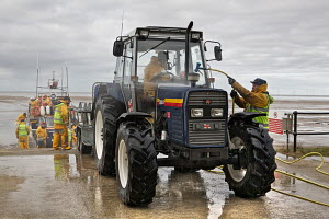 Cleaning tractor following exercise on board the Hoylake RNLI Lifeboat 'Lady of Hilbre'. Hoylake, Wirral, Merseyside, United Kingdom, February 2012. For editorial use only. - Graham Brazendale