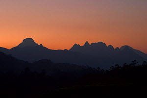 Hills silhouetted against a sunset sky, Western Ghats, Southern India  -  Sandesh Kadur