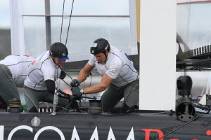 'Green Com Racing' trimming the gennaker as the team round the mark during the America's Cup World Series in Plymouth, England, September 2011. All non-editorial uses must be cleared individually. - Ingrid Abery
