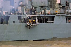 'HMS Liverpool' lowering RIB to transfer personnel, River Mersey, Liverpool, England, March 2012. For editorial use only. - Graham Brazendale