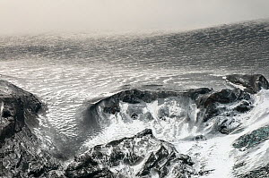 Edge of the Eyjafjallajokull ice cap, partly covered in volcanic ash after the subglacial eruption, Iceland, April 2010  -  Orsolya Haarberg