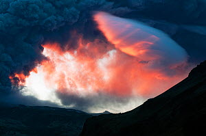 Ash plume from the volcano under the Eyjafjallajokull ice cap, coloured red by the rising Sun, Iceland, 7 May 2010  -  Orsolya Haarberg