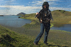 Photographer Orsolya Haarberg surrounded by swarming Midges (Chironomus islandicus) Myvatn, Iceland, June 2008, model released  -  Erlend Haarberg
